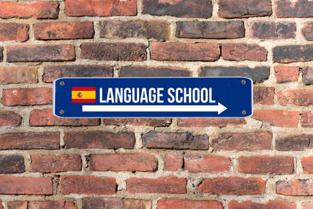 A sign on the wall indicates the language school for Spanish