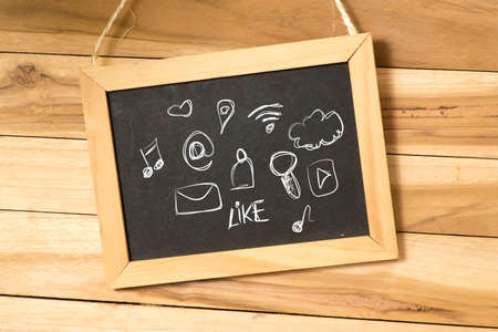 A chalkboard and various icons for social media and streaming on the Internet