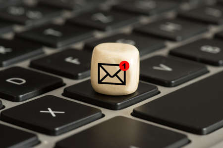 A computer and note to a new email