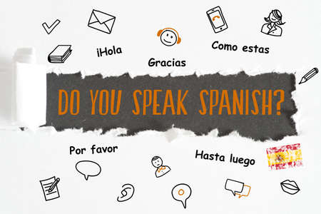 A piece of paper and question. Do you speak Spanish