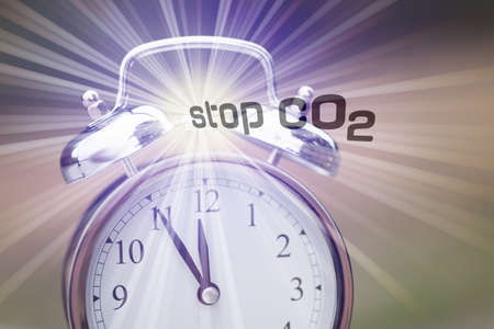 An alarm clock and slogan Stop CO2 carbon dioxide