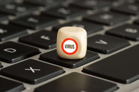 A computer and warning of a virus Banco de Imagens