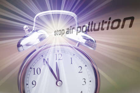An alarm clock and slogan Stop air pollution