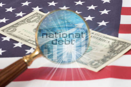 Flag of USA, a magnifying glass, dollar bill and debts in America