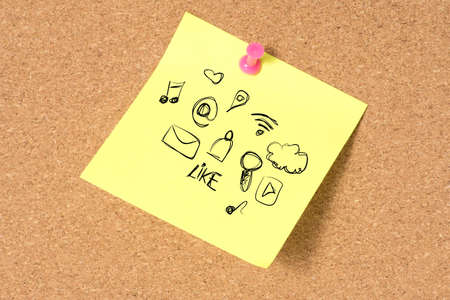 A pin board and a note with various social media icons and streaming on the internet