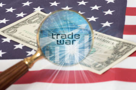 Flag of USA, dollar bill, a magnifying glass and the trade war Reklamní fotografie