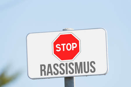 A stop sign and reference to racism Banco de Imagens