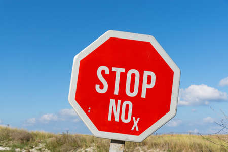 A stop sign and the abbreviation NOx for nitrogen dioxide Stok Fotoğraf