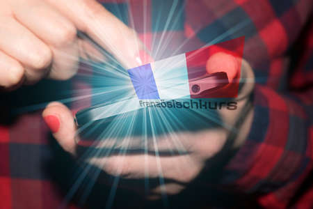 A woman on smartphone, flag of France and language course for French language 版權商用圖片