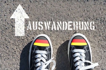 Shoes with German flag and emigration