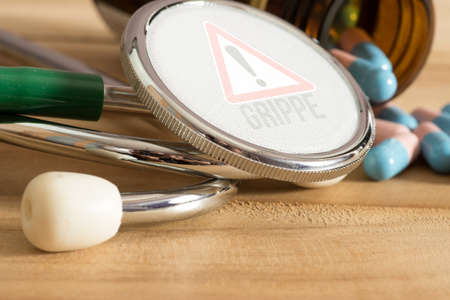 A stethoscope and warning of the flu Stok Fotoğraf
