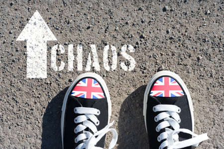 A pair of shoes with flag of Great Britain and chaos Reklamní fotografie