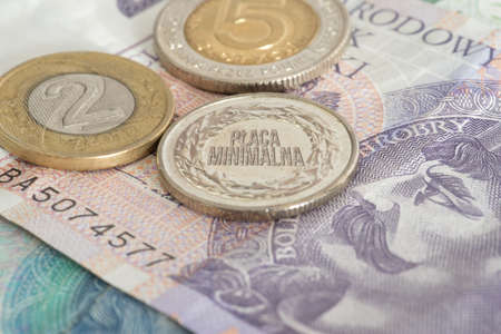 Banknotes and coins Polish zloty PLN and minimum wage in Poland