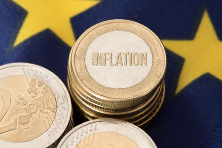 Flag of the European Union EU, Euro coin and inflation in the Eurozone