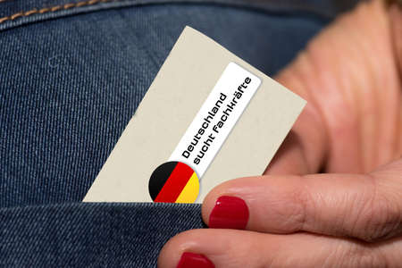 A woman and a map with the slogan Germany is looking for skilled workers