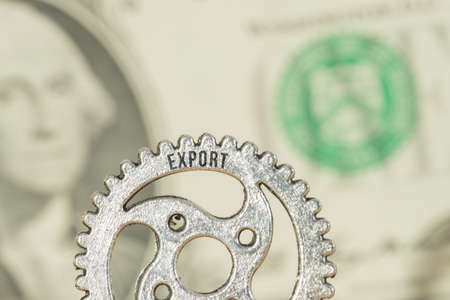 Dollar money and a cogwheel with the imprint Export Reklamní fotografie