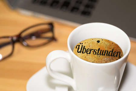 Computer, cup of coffee and the overtime Standard-Bild
