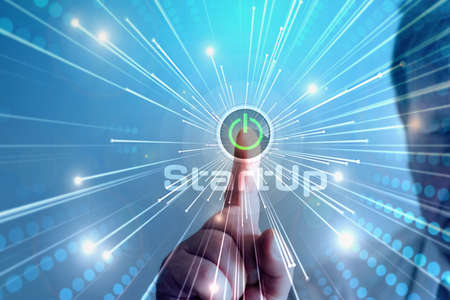 A man presses the switch for startup company Stock Photo