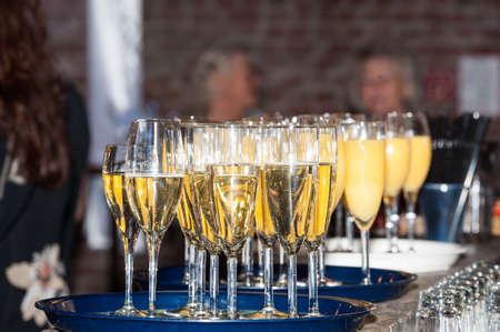 Champagne glasses and juice glasses in a party room