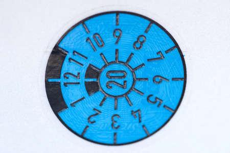Close up of a blue tuv sticker