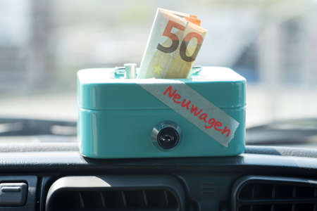 A car, money and money box for new car purchase