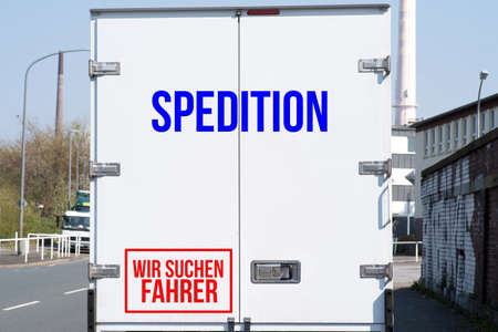 A truck of a forwarding agency and job advertisement for wanted drivers Standard-Bild
