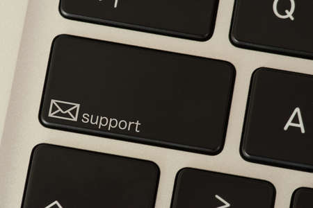A computer and support button