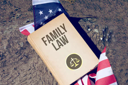 Flag of America and Book Family Law
