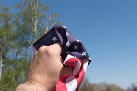 A man and the flag of America Stock Photo