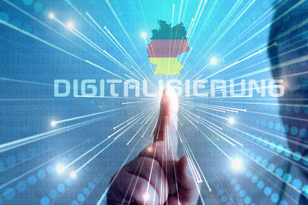 A man touches on the screen symbol for digitization in Germany