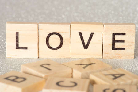The word Love is made of wooden letters Stockfoto