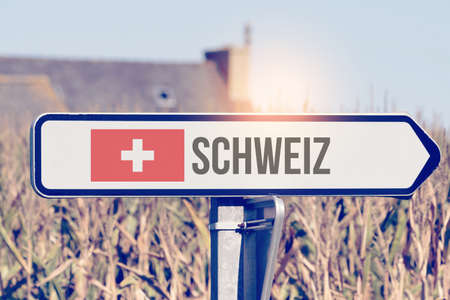 A sign points to Switzerland