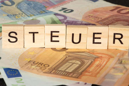 Euro bills and the word tax
