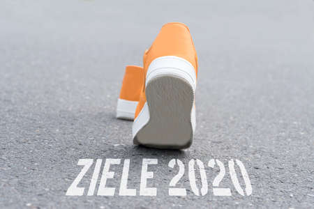 Shoes and writing goals 2020 on a street Standard-Bild