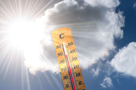 A thermometer and heat in summer