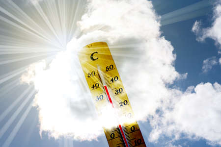 A thermometer and heat in summer Stock Photo