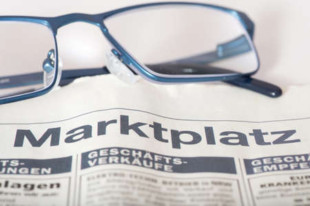 A newspaper, marketplace and glasses
