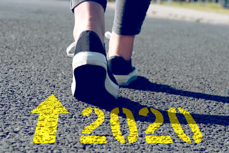 A woman is heading towards the year 2020