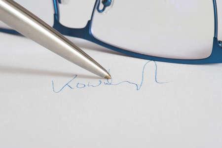 A pen and a signature