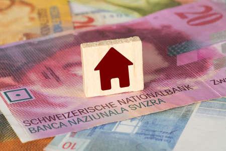 Schweizer Franken CHF und ein Haus