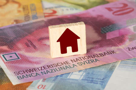 Swiss franc CHF and a house
