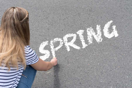 A woman and spring Imagens