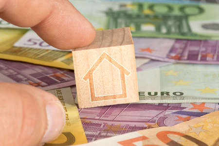 Euro bills and a house
