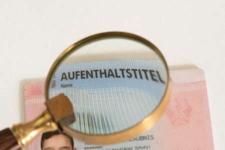 Residence permit under a magnifying glass