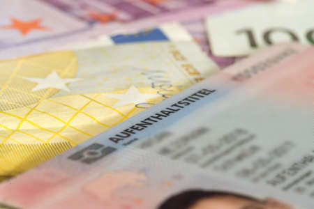 Euro banknotes and residence permit for Germany Archivio Fotografico