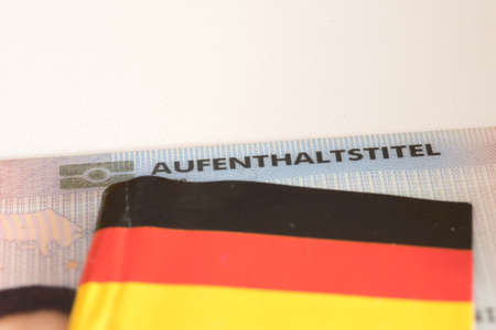 Residence permit and German flag