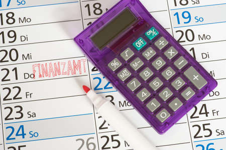 Calendar, calculator and appointment at the tax office Stock Photo