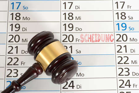 A calendar with an appointment for divorce and judge gavel