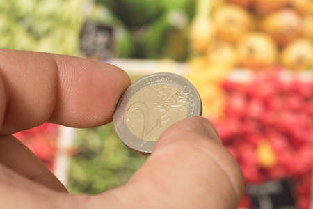 Euro coins and food
