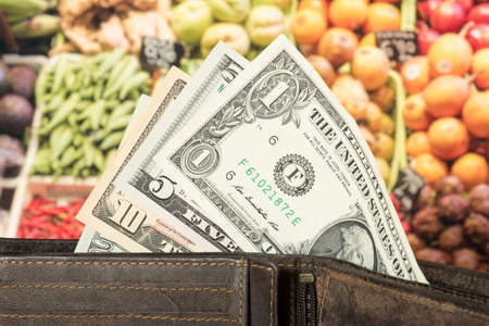 A wallet, dollar bills and food prices in USA Banco de Imagens